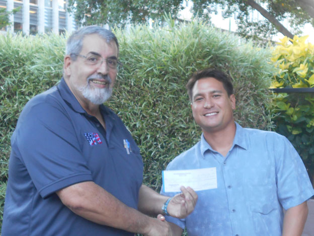 2018 December 5 JVC Ron Lockwood presents $1,000.00 VFW grant check to UH Hawaii Student Veteran of America Representative
