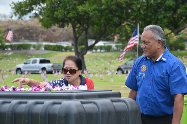 2018 May 30 Dept. Aux President and SVP at Pbowl, laying Leis on Casket of WWII Oklahoma Ship Veteran.